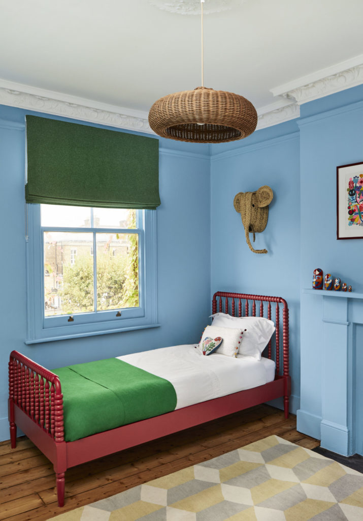 Walls and fireplace in 'Enamel Blue 78' paint,, bed in 'Red Post Hill 68' paint, Mylands at Colony